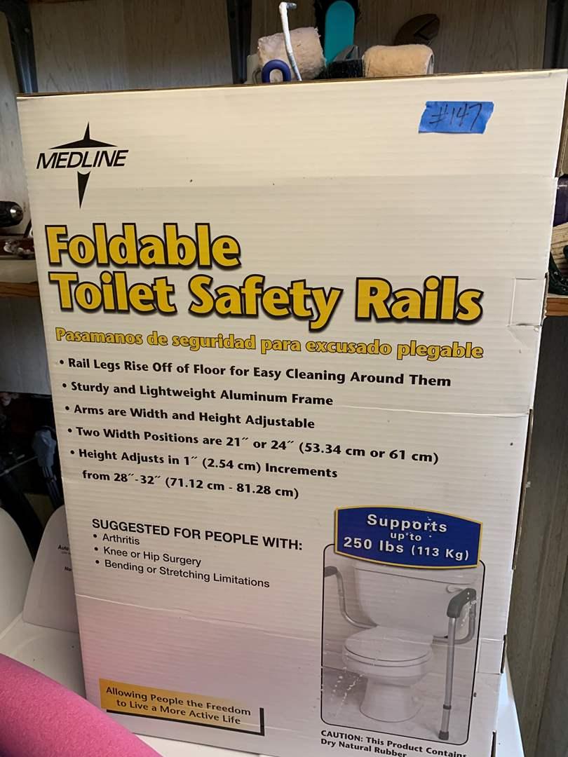 Lot # 147 foldable toilet safety rails