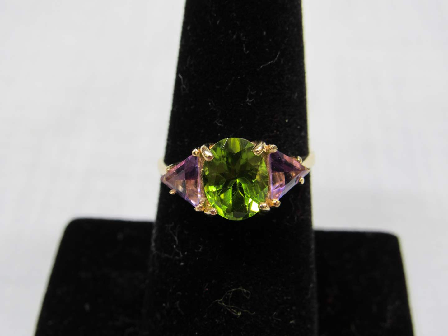 Lot # 105  Green and Amethyst colored stones 14K gold size 8 ring 2.42 grams  (main image)
