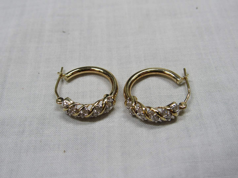 Lot # 109  Cute 14K gold & channel diamond earrings 1.89 grams (main image)