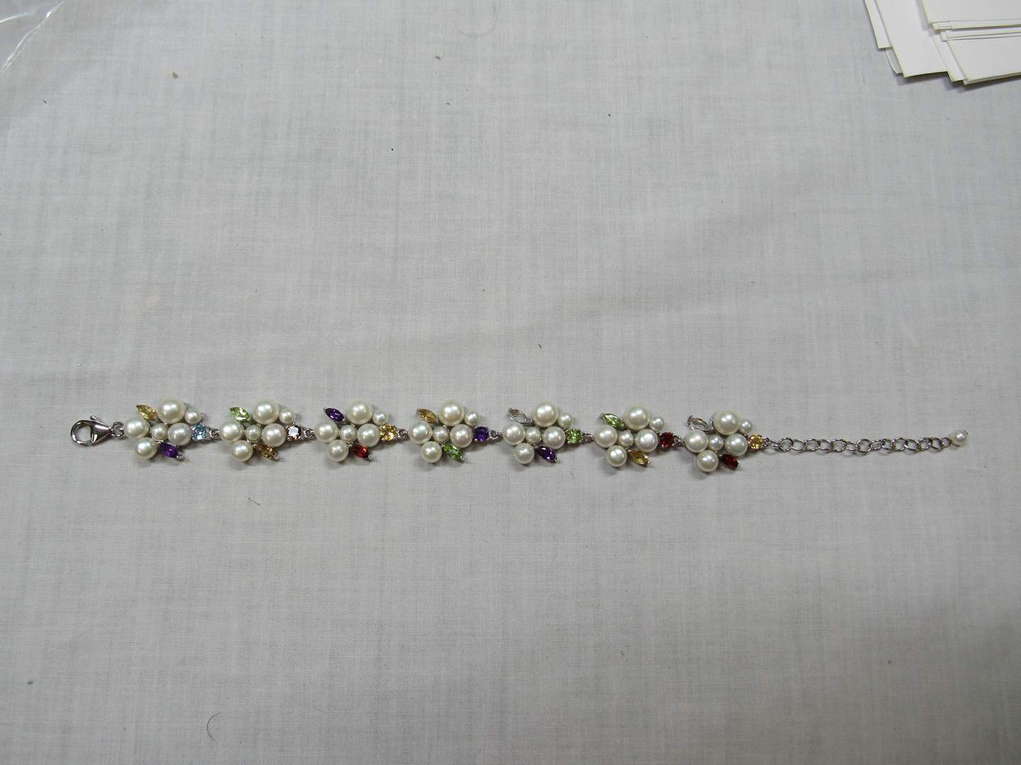 Lot # 112  Beautiful sterling silver w/multi colored stones and seed  pearls bracelet (adjustable)  (main image)
