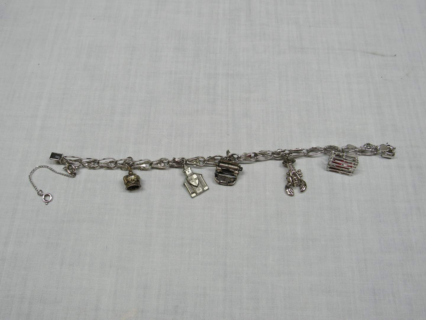 Lot # 182  Vintage sterling silver charm bracelet with charms (main image)