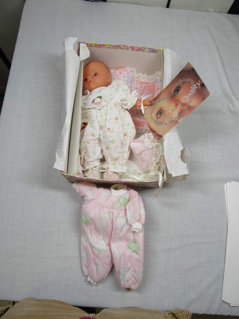Lot # 18  Cute Baby Doll with papers (no lid for box) (main image)