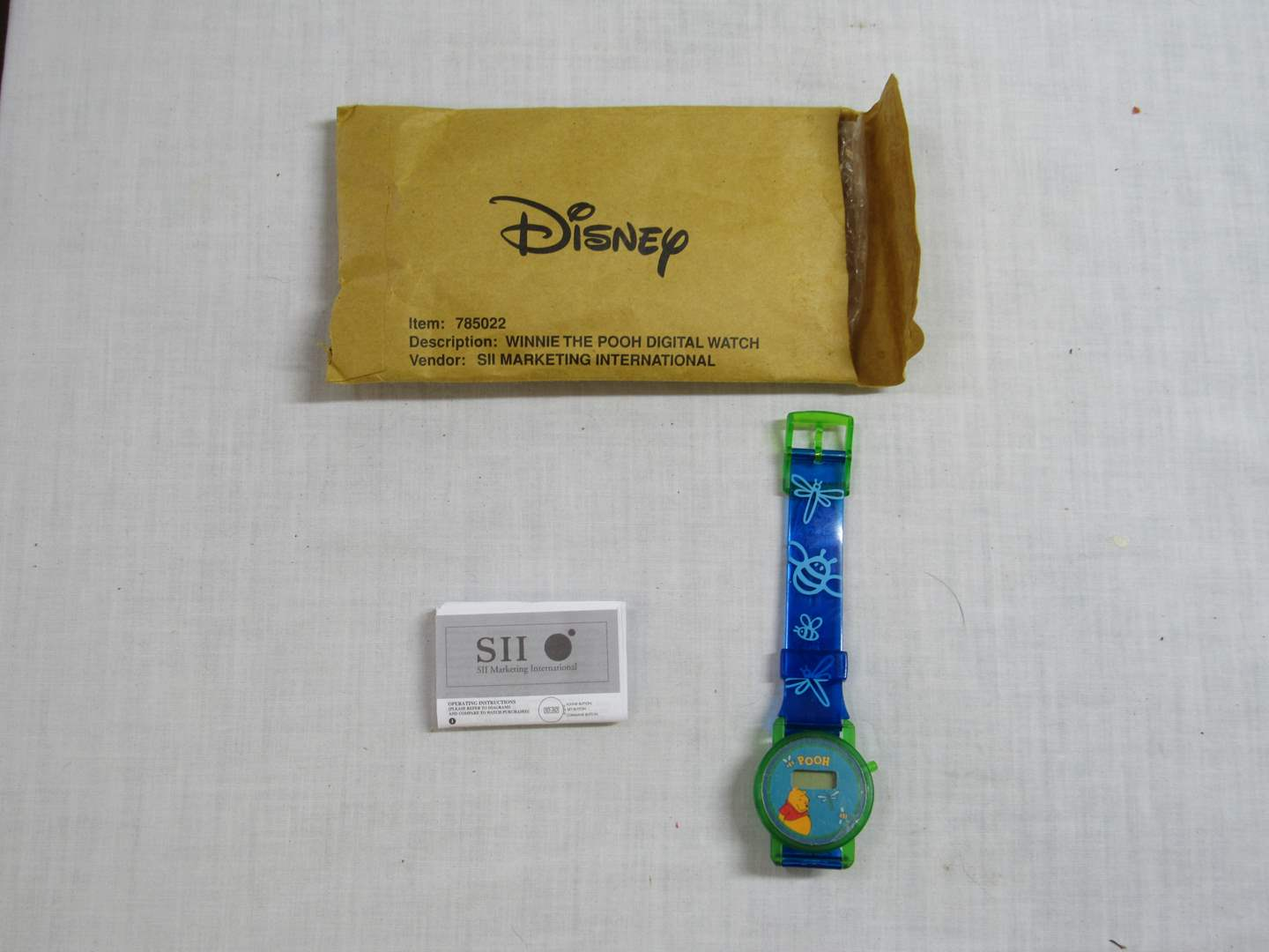Lot # 35  New Never worn Winnie the Pooh Disney Watch (will need a battery) (main image)