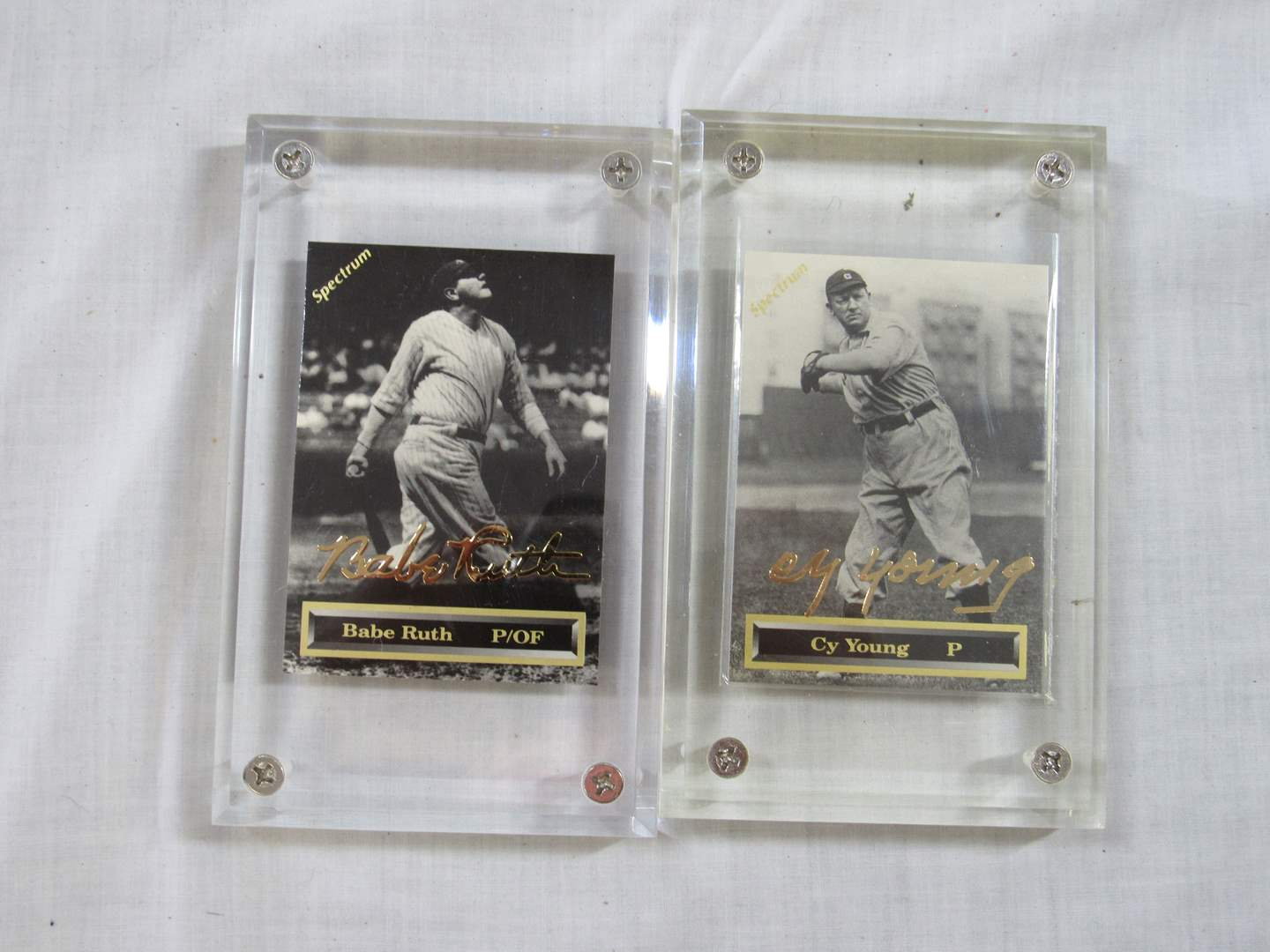 Lot # 40   Grouping of collectible sports cards in hard cases (main image)