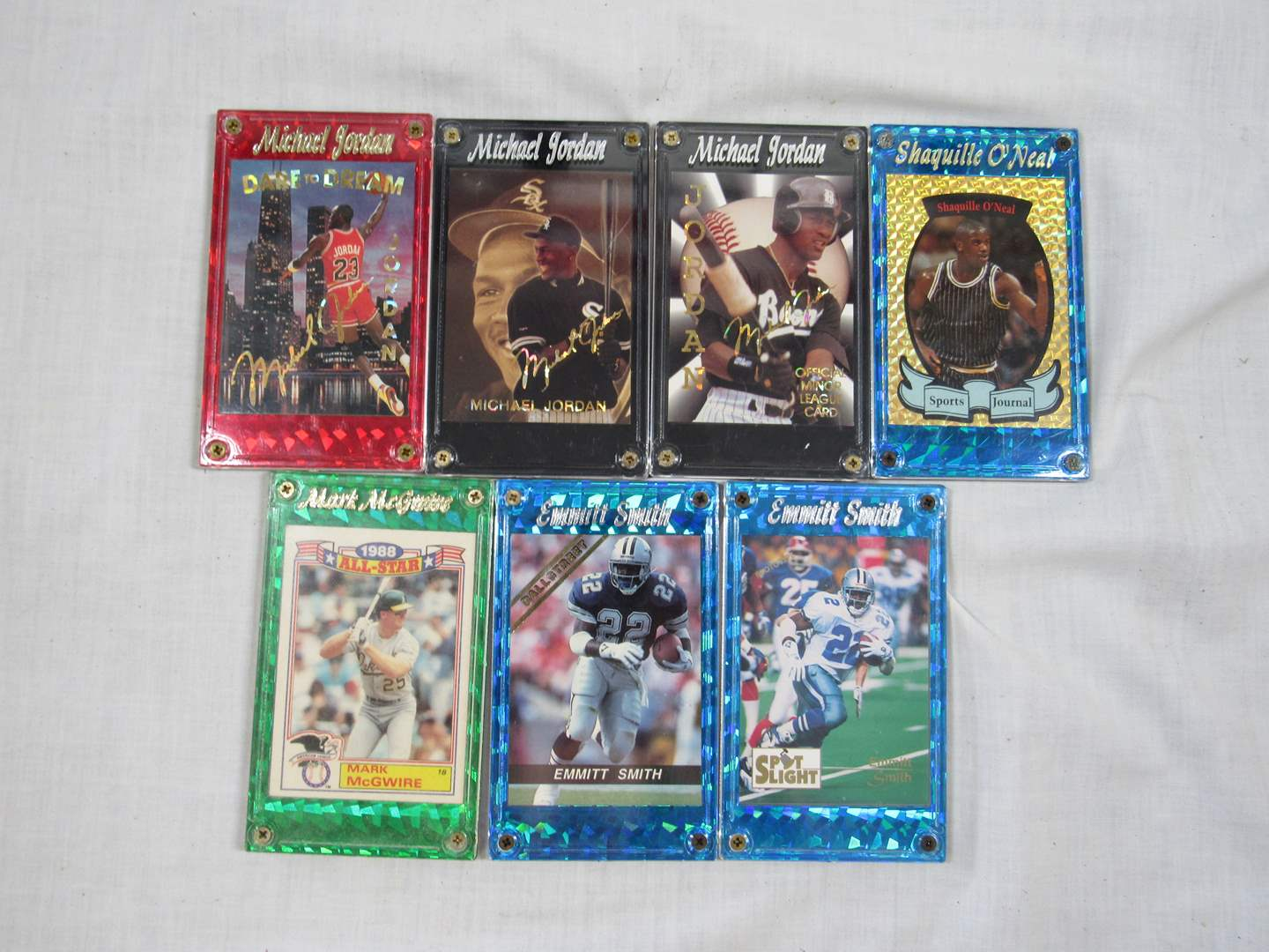 Lot # 41  Grouping of collectible sports cards in hard cases (main image)