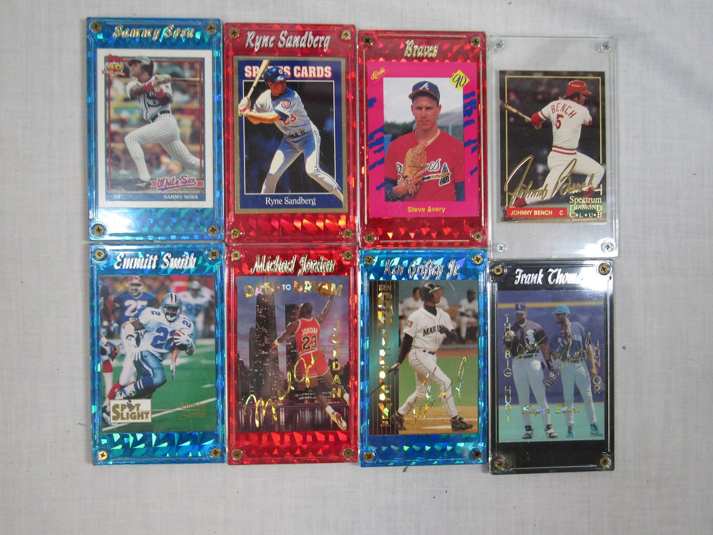 Lot # 43  Grouping of sports cards in hard cases (main image)