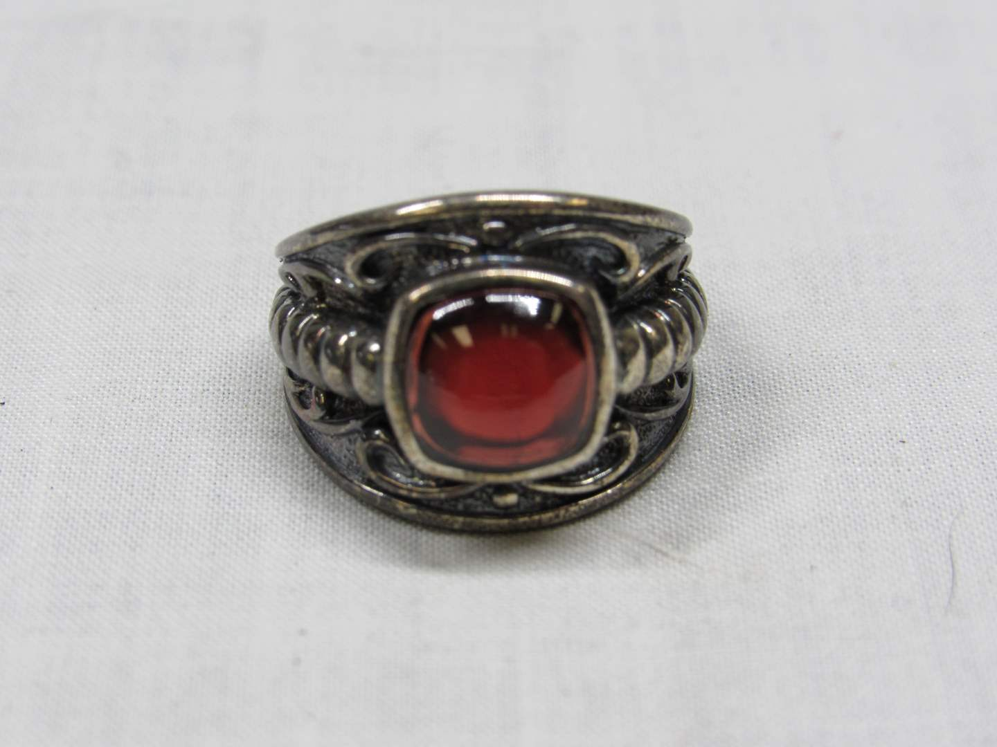 Lot # 204  Great Sterling Silver six 5 ring with red moon stone (main image)