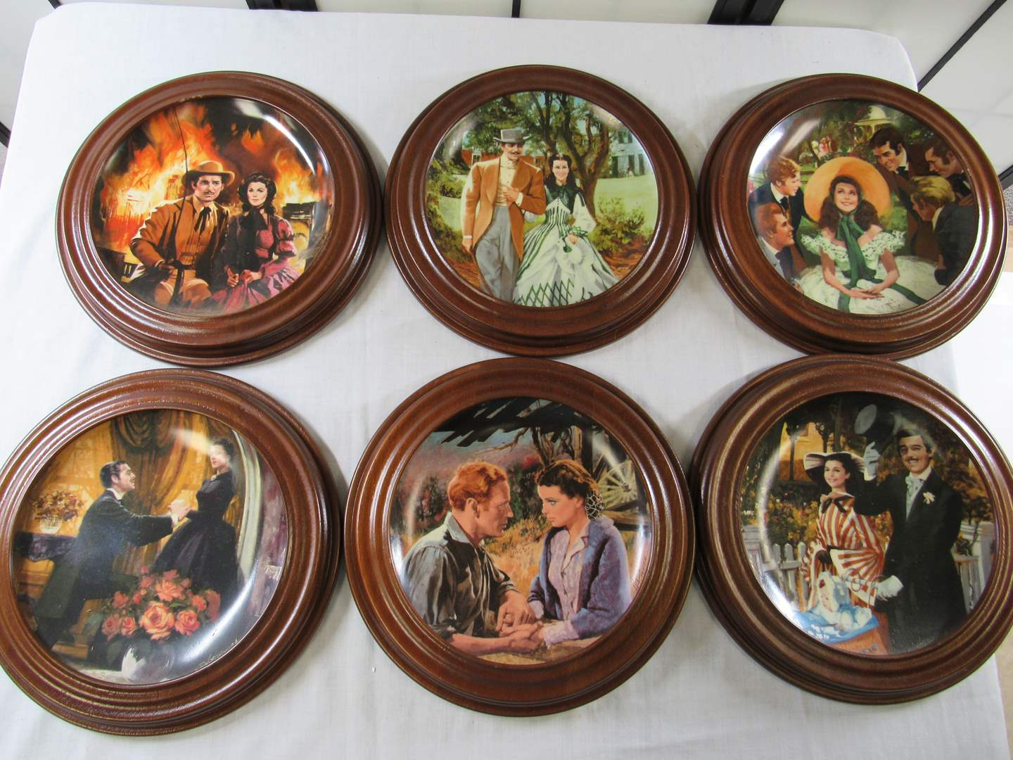 """Lot # 227  Great lot of """"Gone with the Wind"""" collector plates with wood holders (needs a GOOD cleaning) (main image)"""