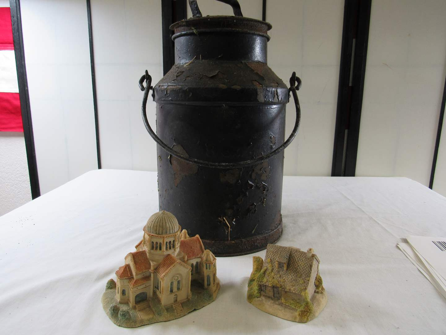 Lot # 232  Vintage 2 Gallon milk can (needs repainted) & 2 sand houses (main image)