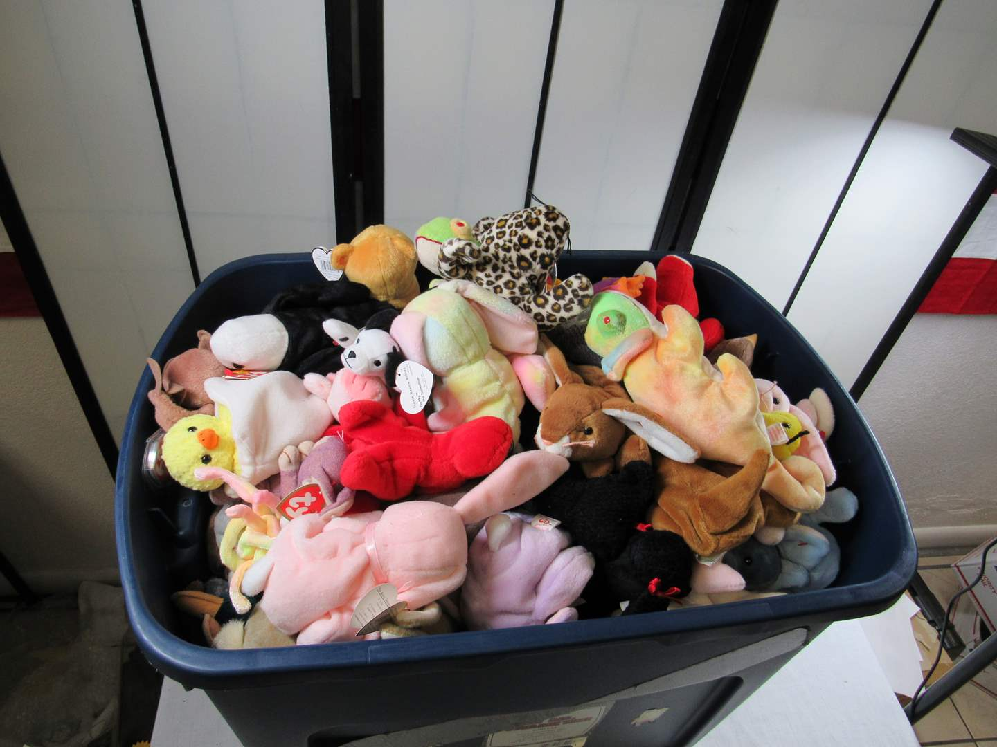 Lot # 296  About 100 Beanie Babies most with tags (these came out of a smokers house and still have a hint of smoke smell)   (main image)
