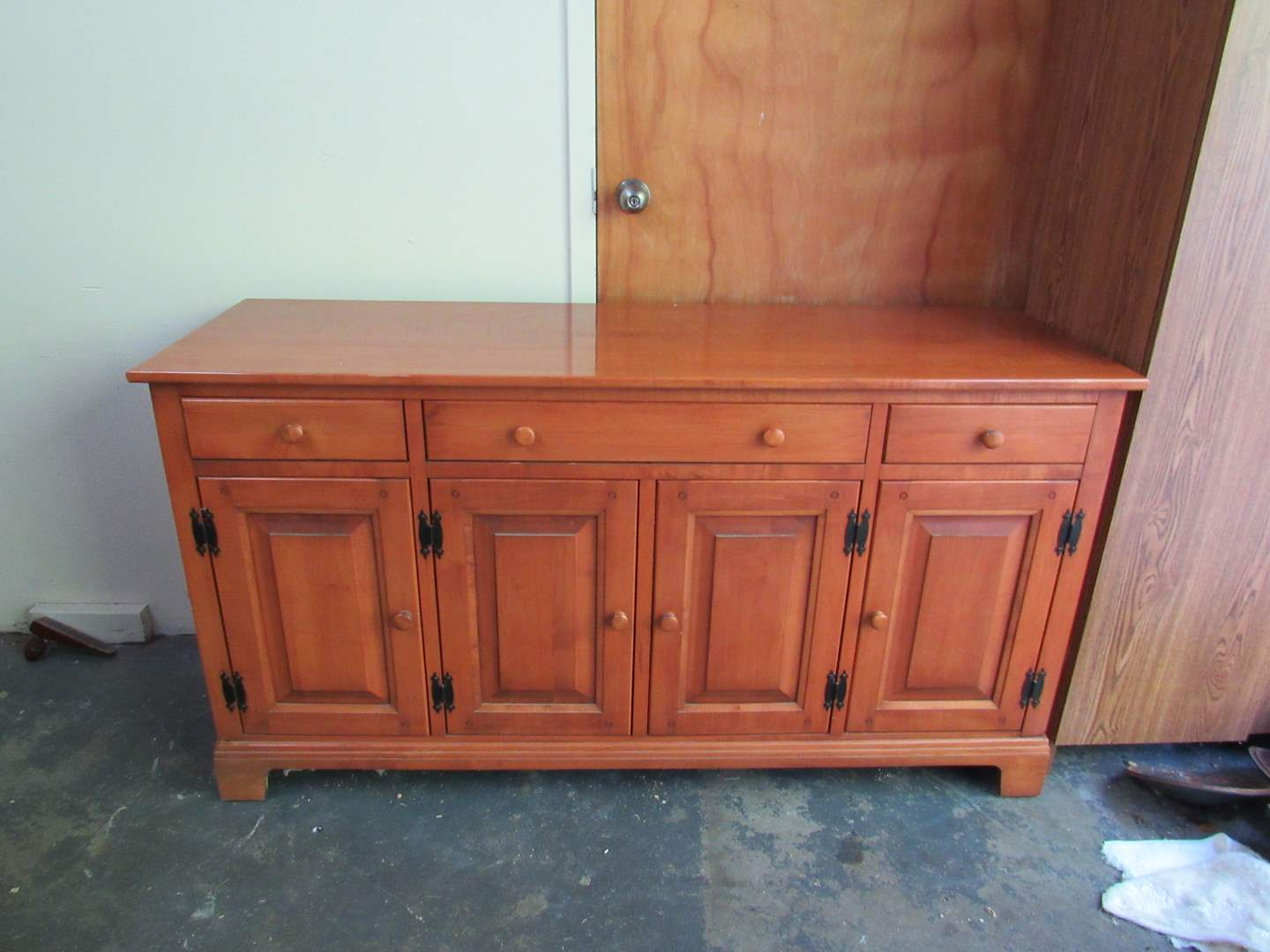 Lot # 62  HEAVY Made in USA Maple side board (could second as a TV stand)  (does have some surface scratches) 59X19X32 (main image)