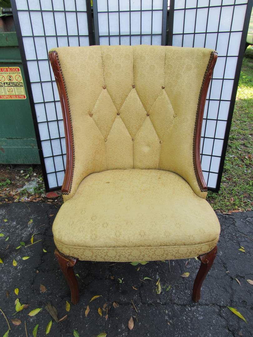 Lot # 66  Great 1/2 wing antique tufted chair with mahonony accents (solid chair) (main image)