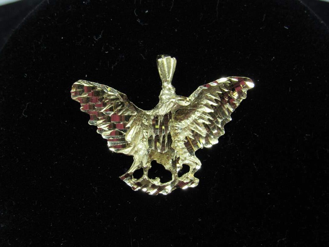 """Lot # 103  Eagle 14K pendant 3.78 grams 1 1/4"""" across (main image)"""