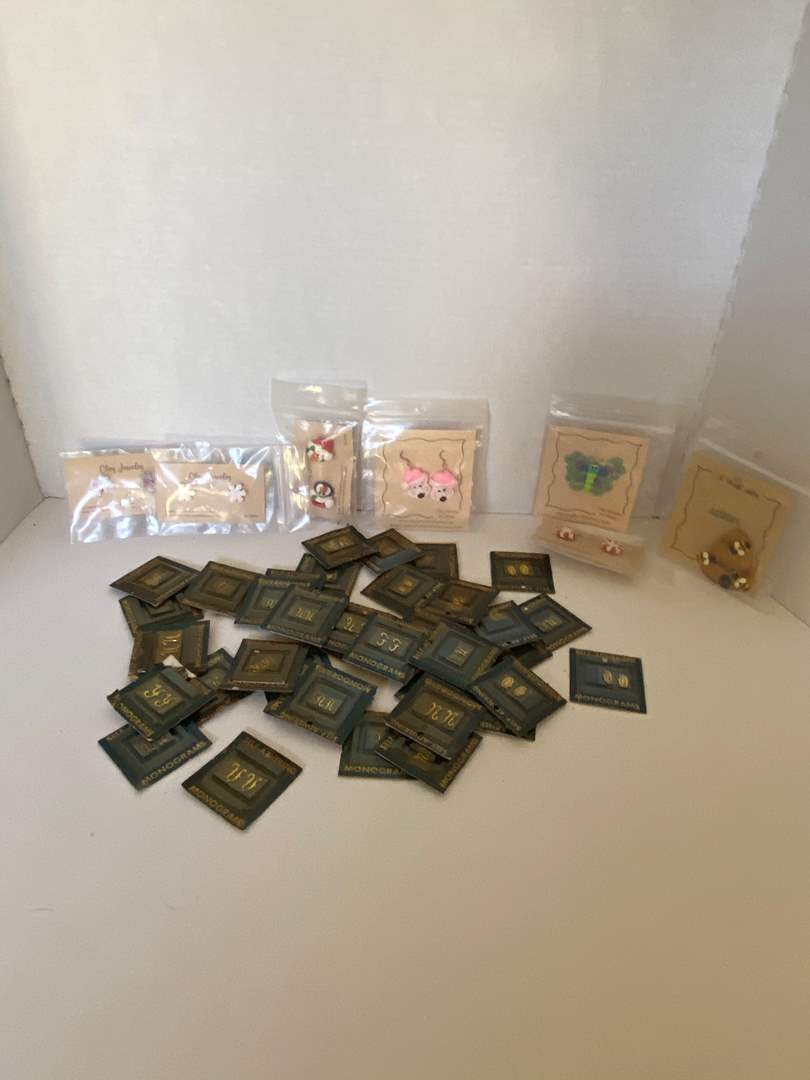 Lot # 23 collection of Self Adhering Monograms & Clay Jewelry