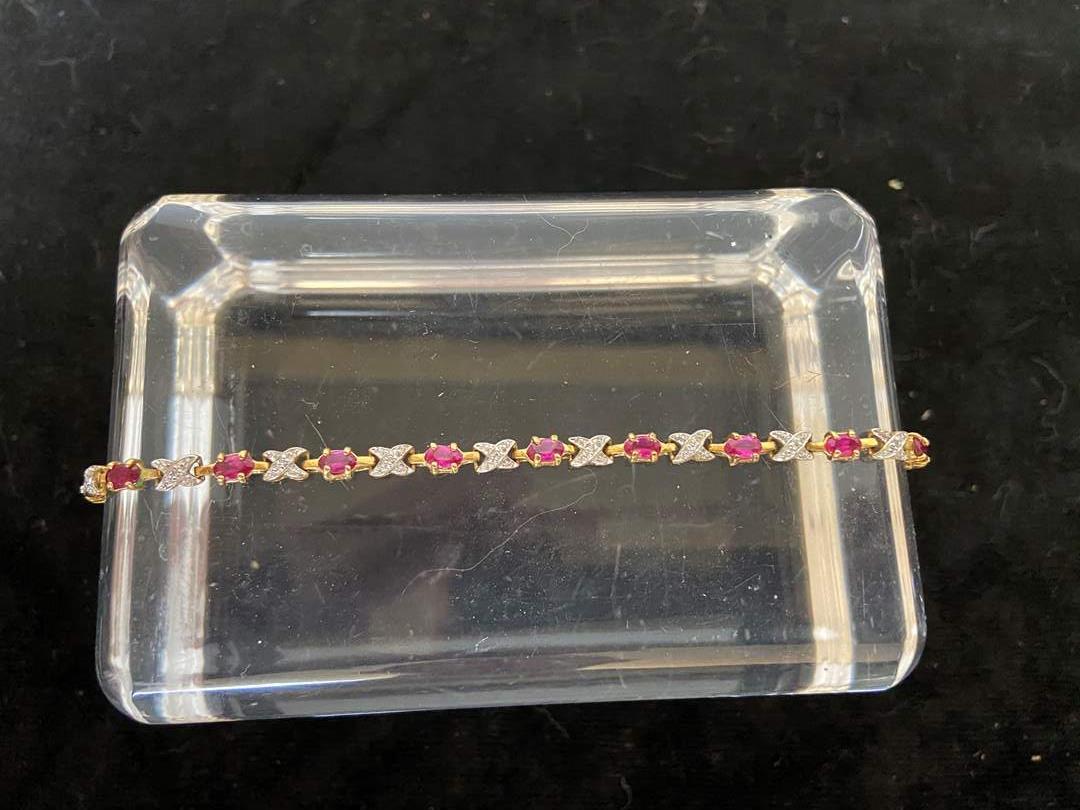 Lot # 105 Beautiful Gold toned sterling silver tennis bracelet