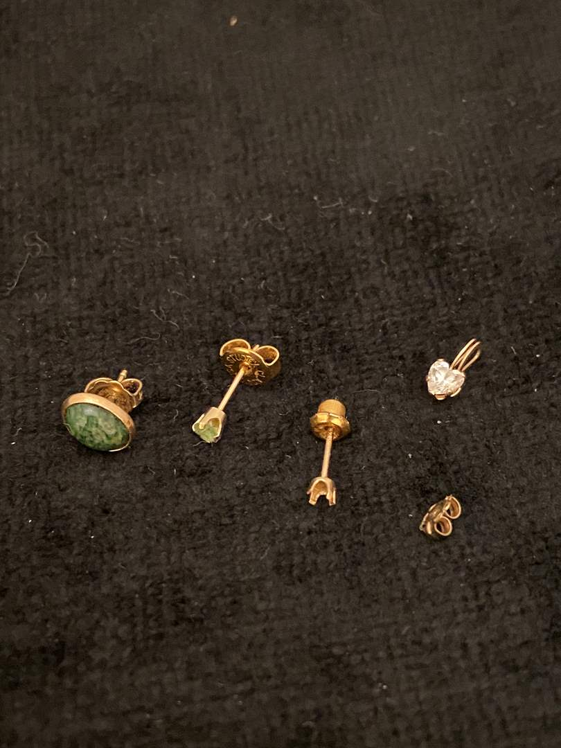 Lot # 359 14K Gold Mismatched Earrings & Charm - TW is 1.4g