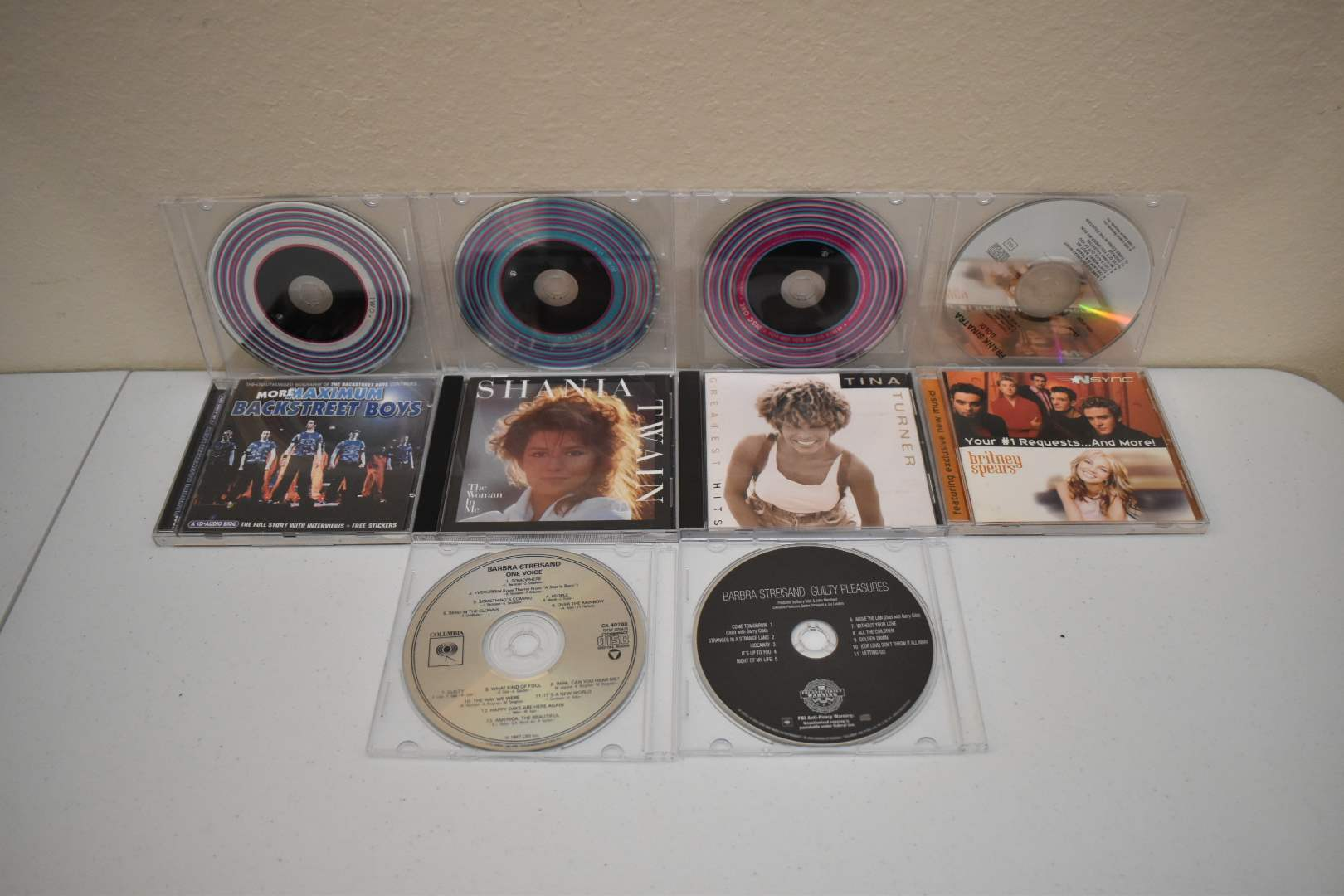 CDs: Hits of the 1950's and 60's, Backstreet Boys, etc