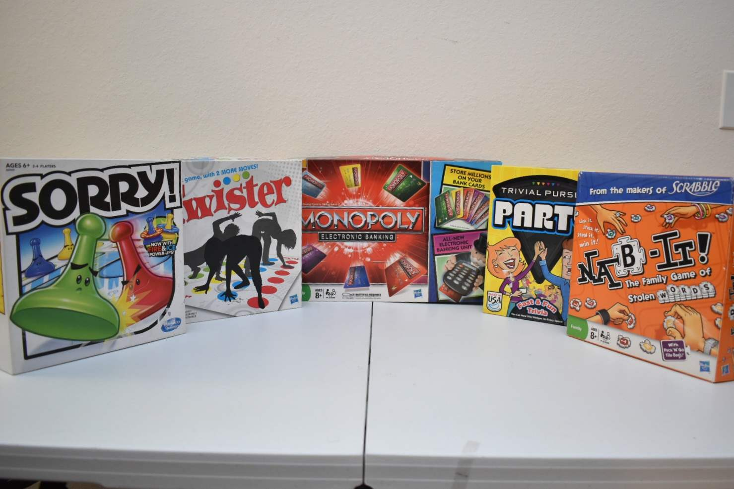 Board Games: Electronic Monopoly, Nab-It, Sorry, Twister, Trivial Pursuit Party