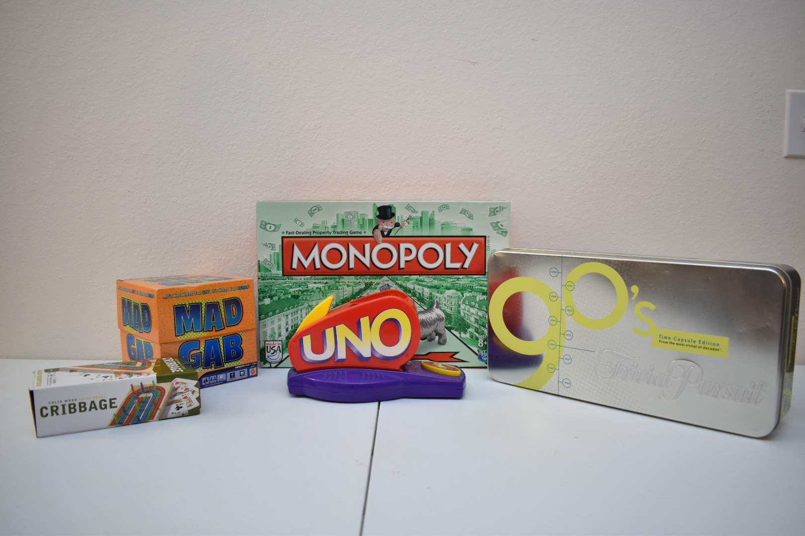 Board Games: Uno Attack, Monopoly, Mad Gab, Cribbage, '90s Trivial Pursuit