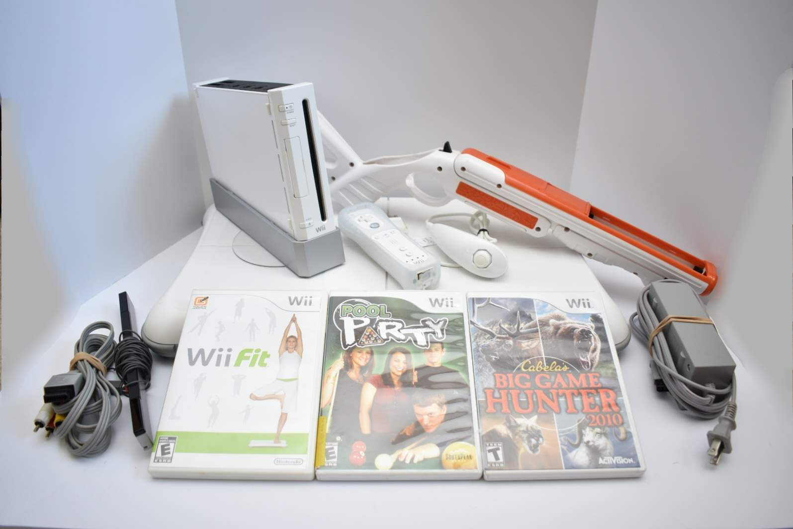Nintendo Wii Bundle with Wii Fit Board and Cabela's Gun