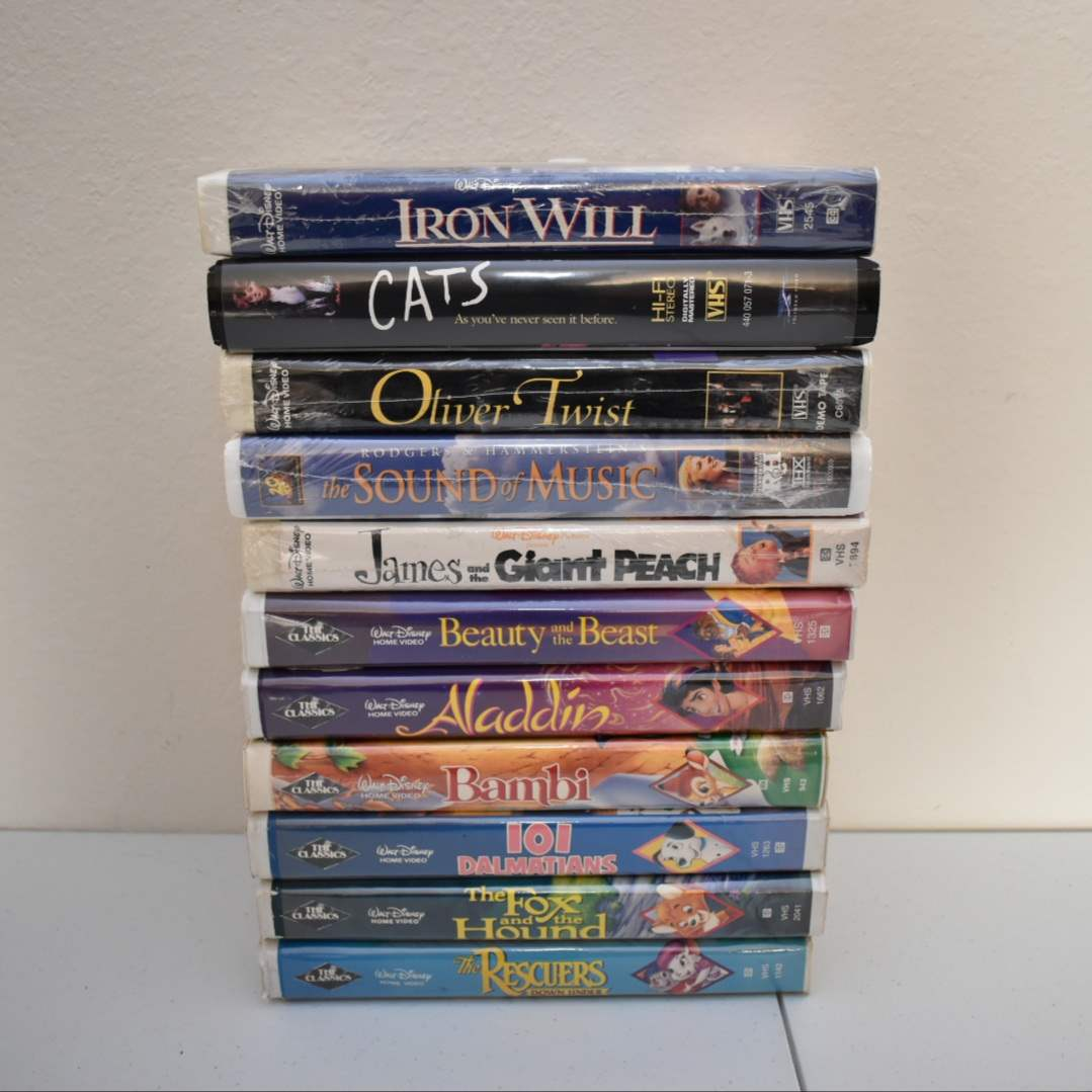 VHS lot with *SEALED* Sound of Music, Oliver Twist, Iron Will, James and the Giant Peach, and Disney Black Diamond Labels