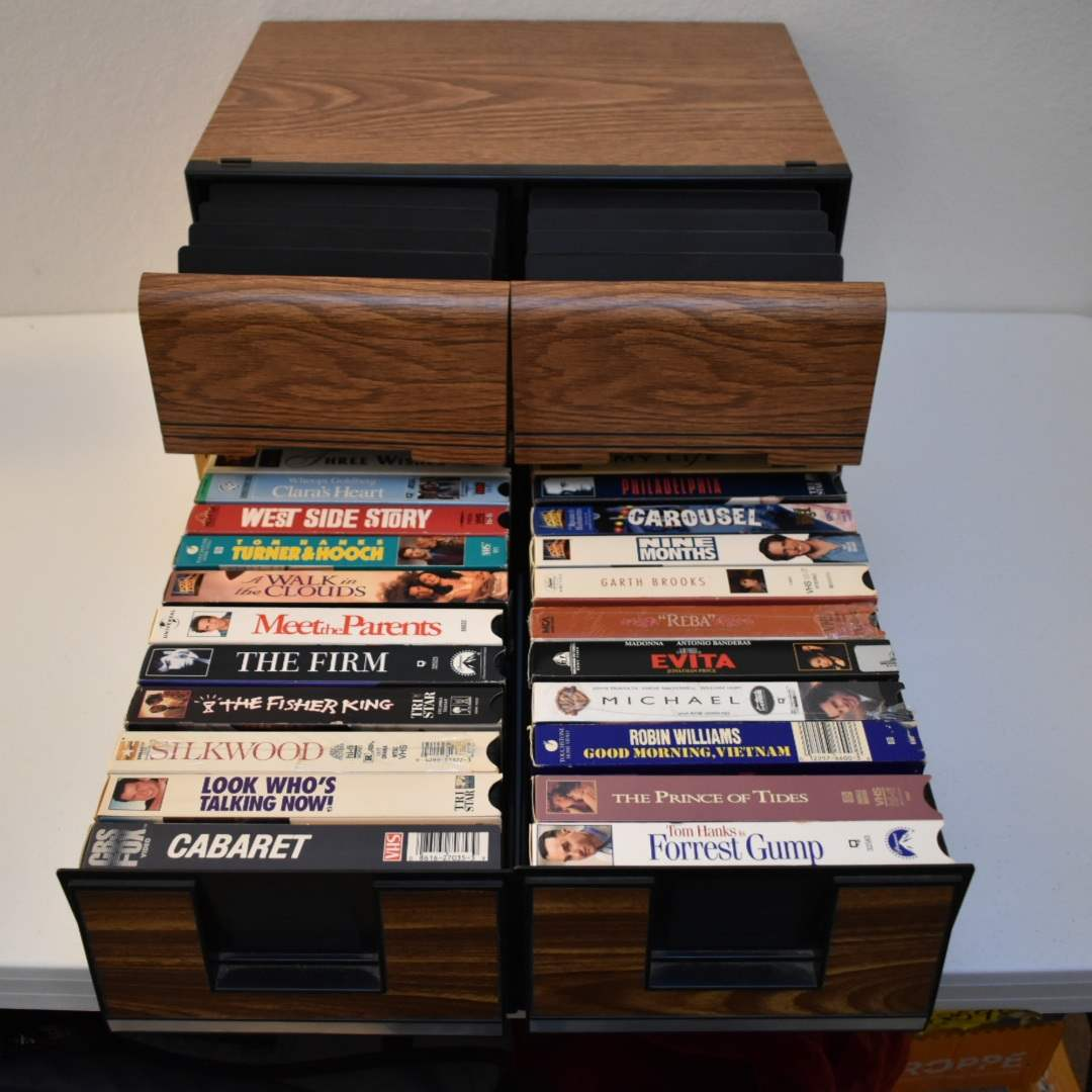 (2) Vintage VHS Holders with Tapes