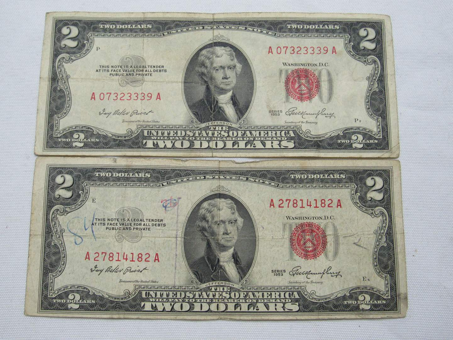 Lot # 128  2 Red Note two dollar bills (main image)