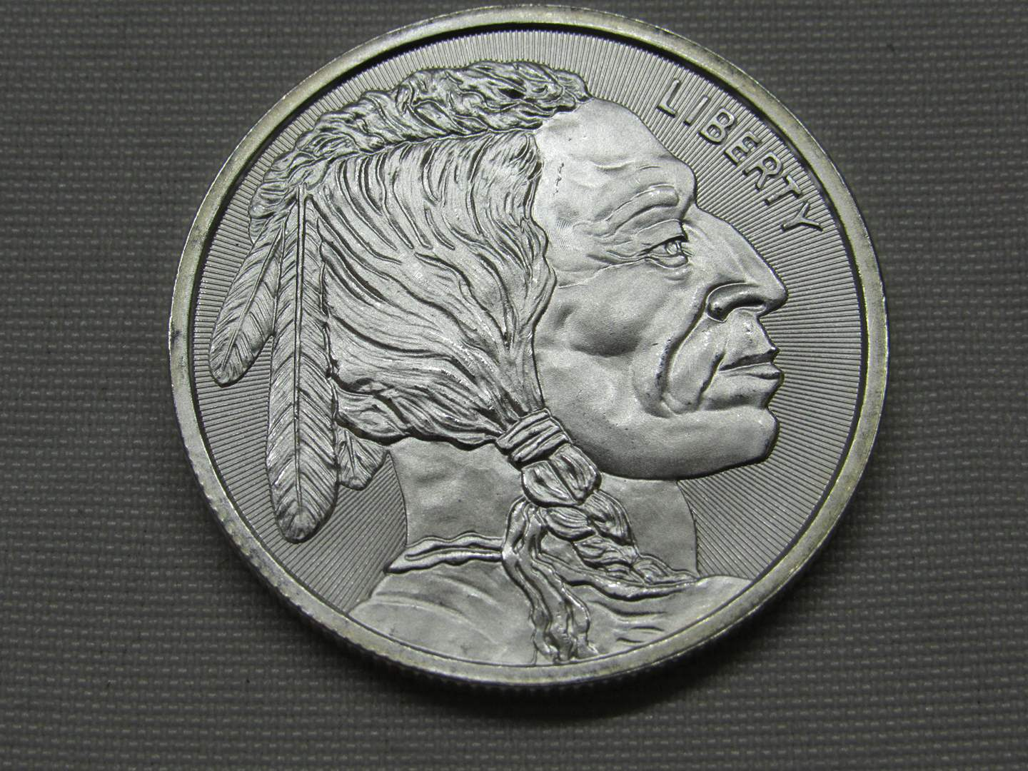 Lot # 135  1 UNCIRCULATED one ounce .999 Silver round Buffalo & Indian Head (the color is not as shown coin is BRILLIANT) (main image)