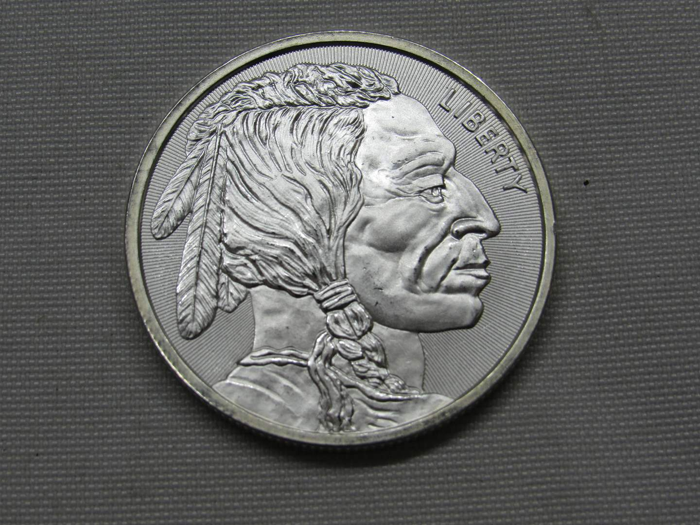 Lot # 136  1 UNCIRCULATED one ounce .999 Silver round Buffalo & Indian Head (the color is not as shown coin is BRILLIANT) (main image)