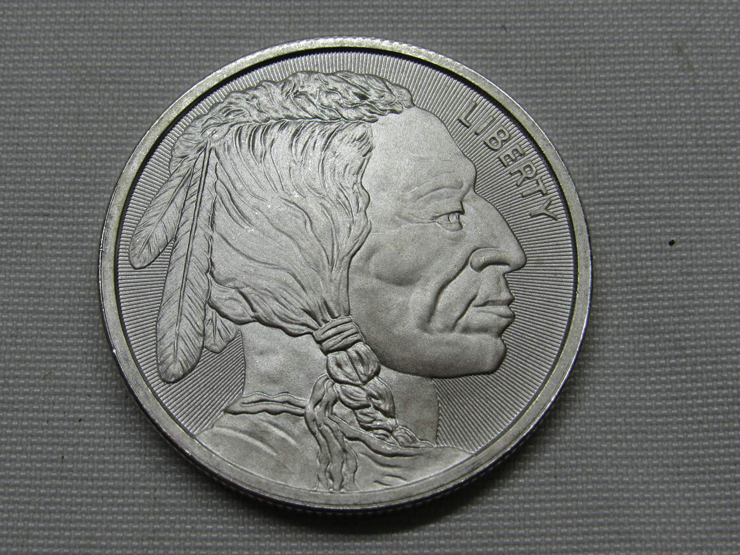 Lot # 137  1 UNCIRCULATED one ounce .999 Silver round Buffalo & Indian Head (the color is not as shown coin is BRILLIANT) (main image)
