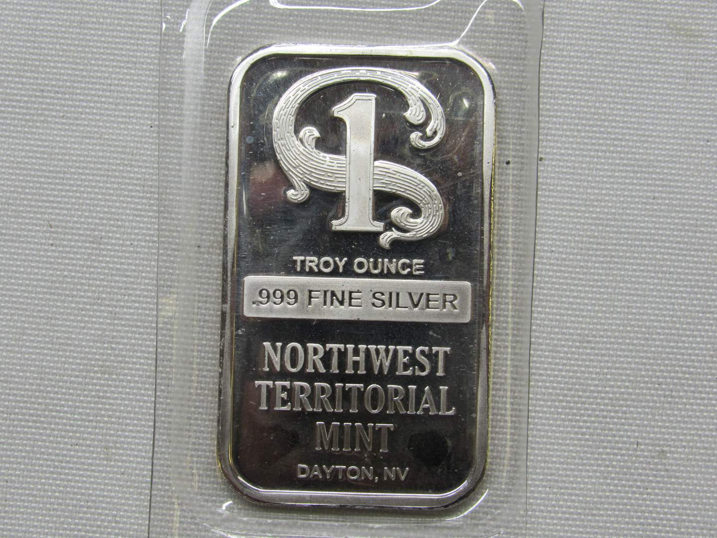 Lot # 144  Great Sealed .999 One ounce Northwest Territorial Silver Bar (BRILLIANT) (main image)