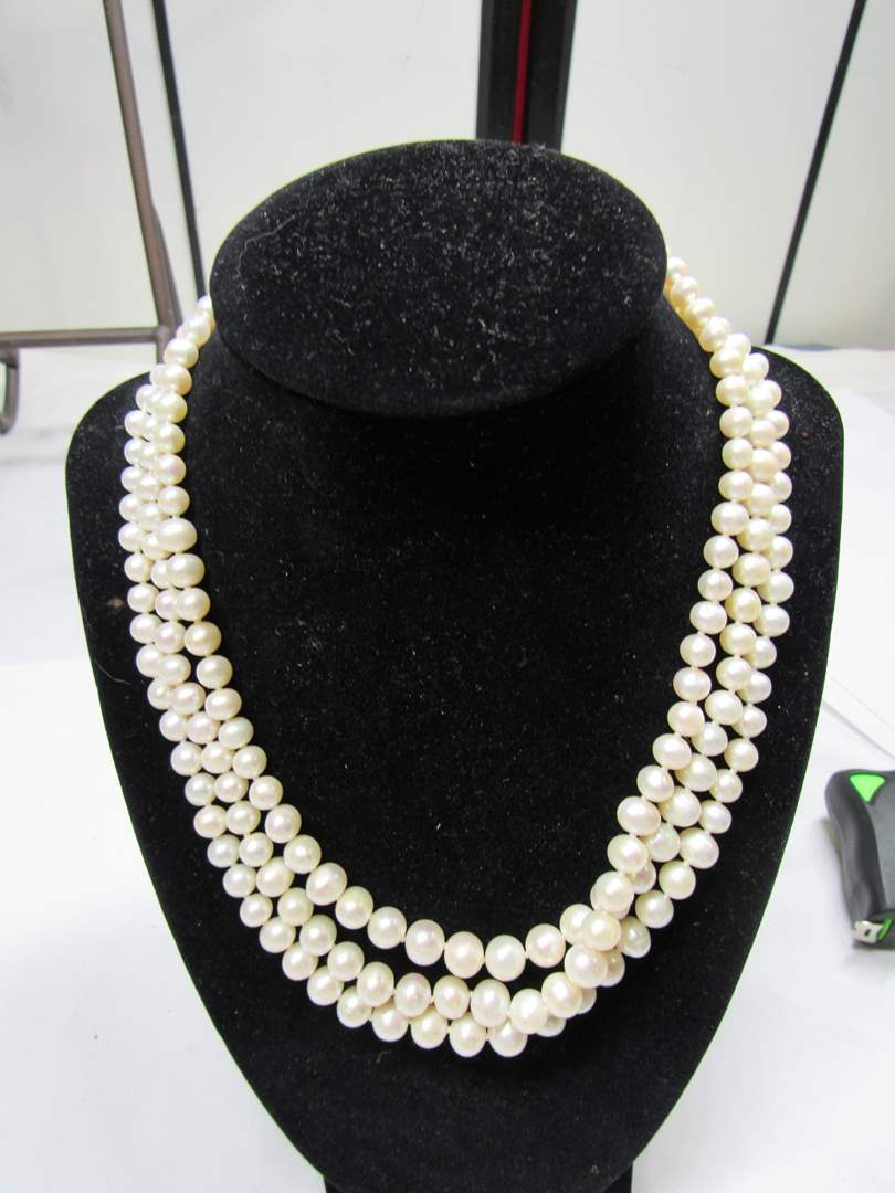 Lot # 184 AMAZING triple strand of REAL pearls with sterling clasp (main image)