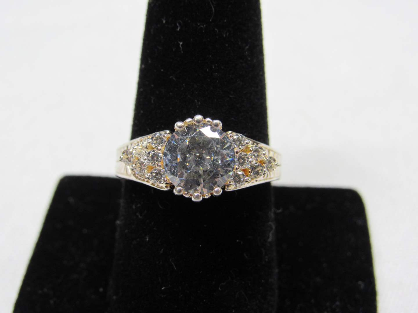 Lot # 227  Large center stone (no it is not blue) CZ & sterling silver size 9 ring (main image)