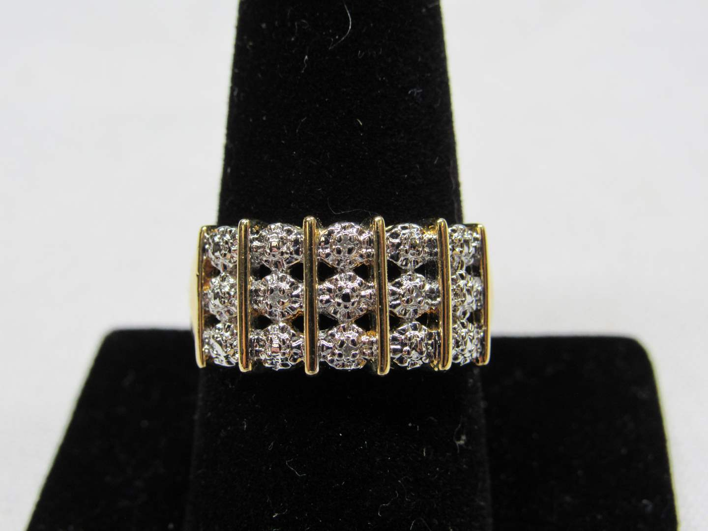 Lot # 228  Gold over sterling silver & triple band of CZ's size 9 ring (main image)