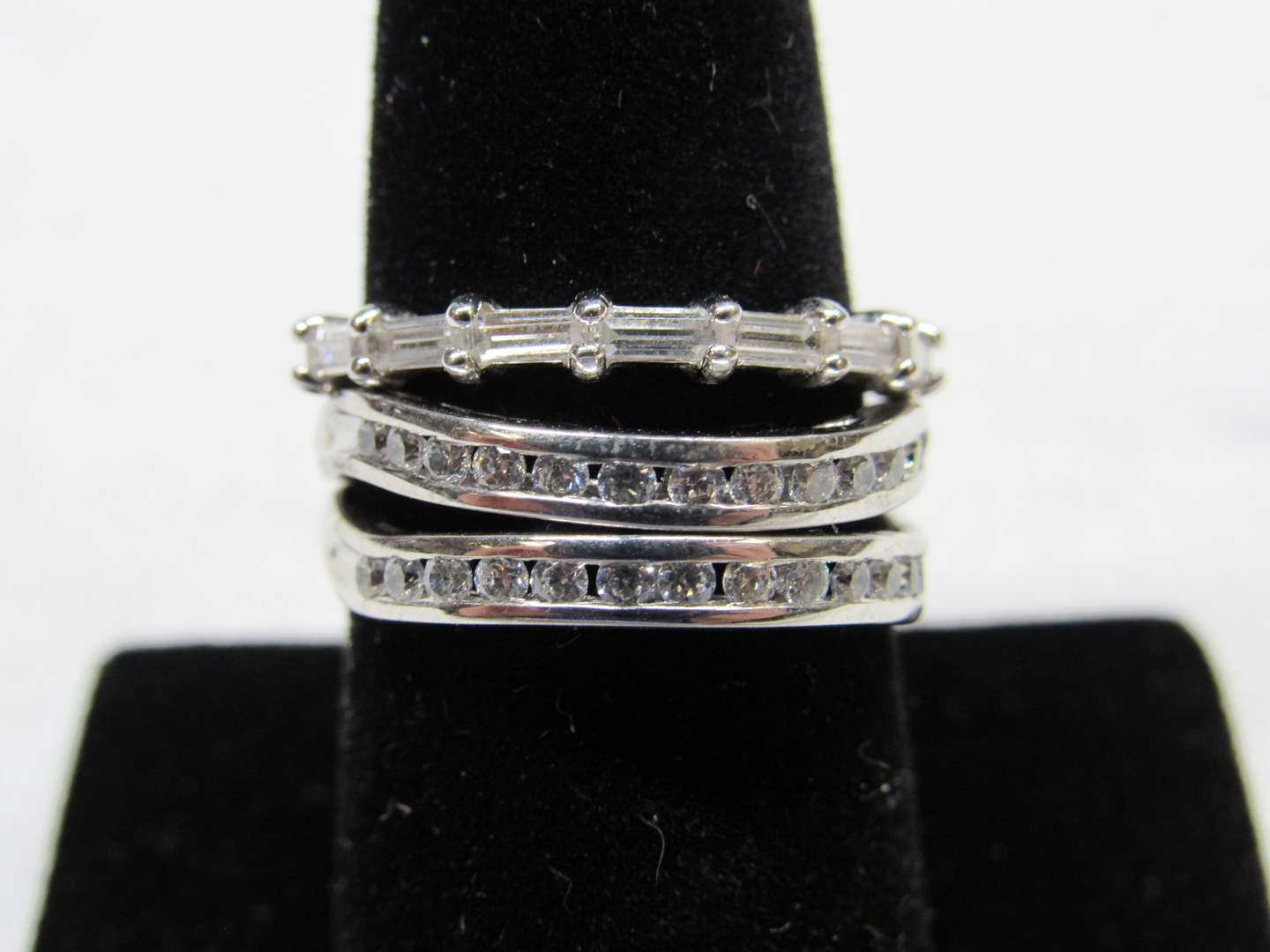Lot # 232  3 Sterling silver & CZ's rings size 8 (main image)