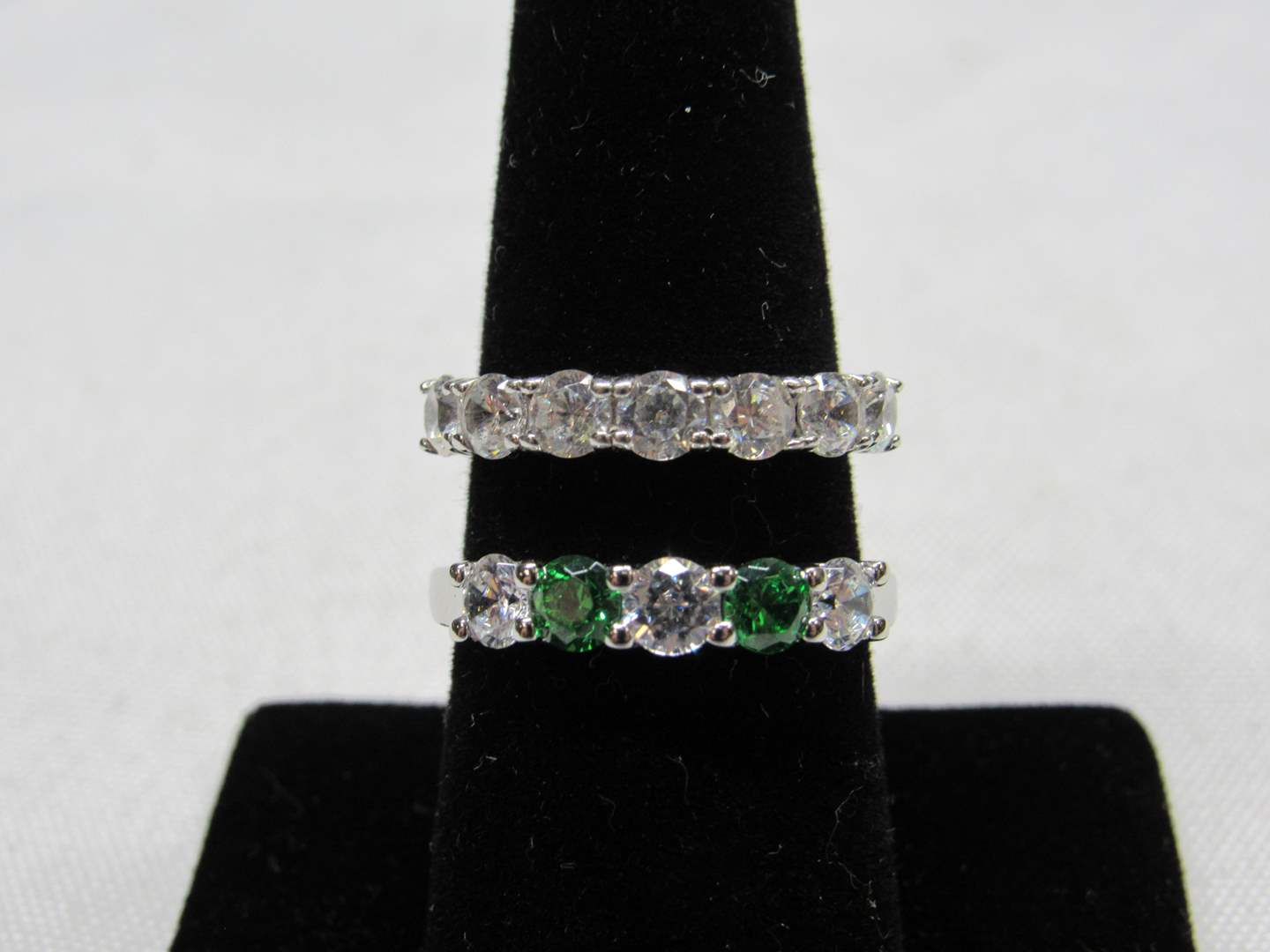 Lot # 234  2 sterling silver rings w/cz's and green accents size 7&8 (main image)