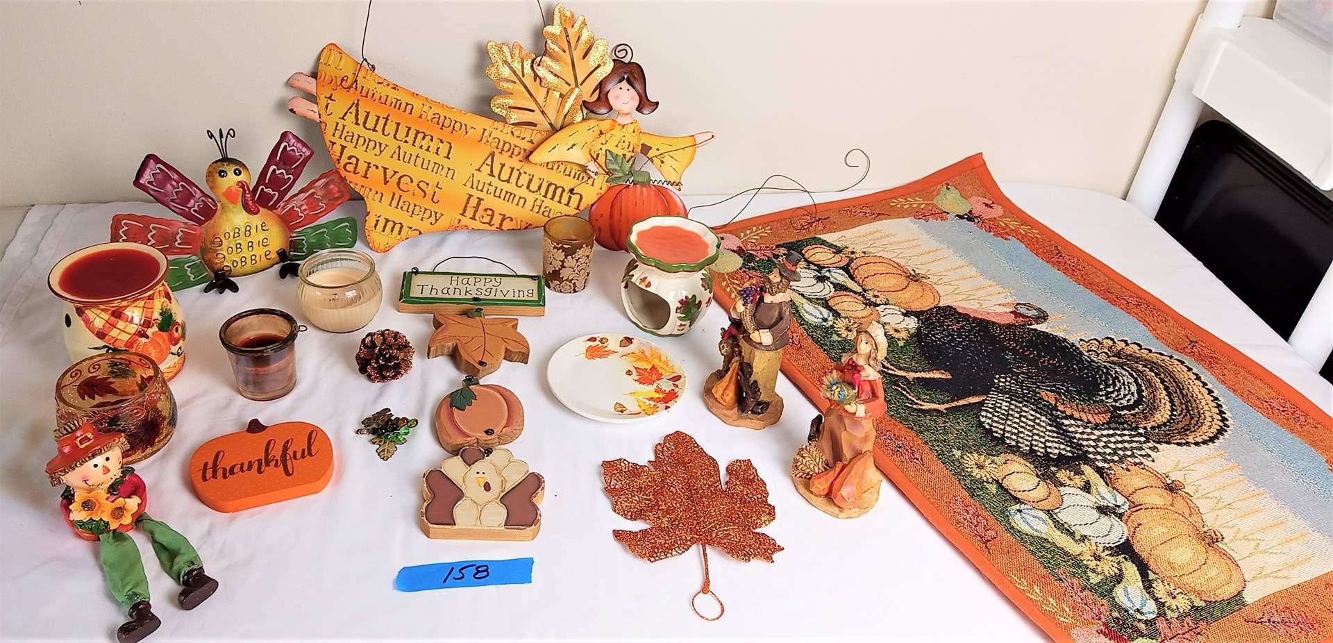 Lot # 158 Thanksgiving Collection: Hanging metal Sign, Floor Mat, 6 misc candle holders, Metal Turkey, wood pligrim figures,