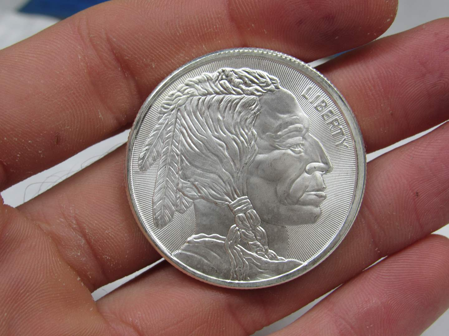 Lot # 101  High quality and brilliant bright .999 Buffalo Indian one ounce silver round (main image)