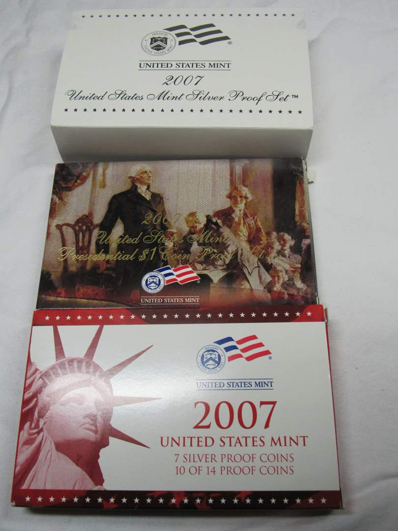 Lot # 122  2007 Mint SILVER PROOF coin set w/silver quarters and gold tone dollars (main image)