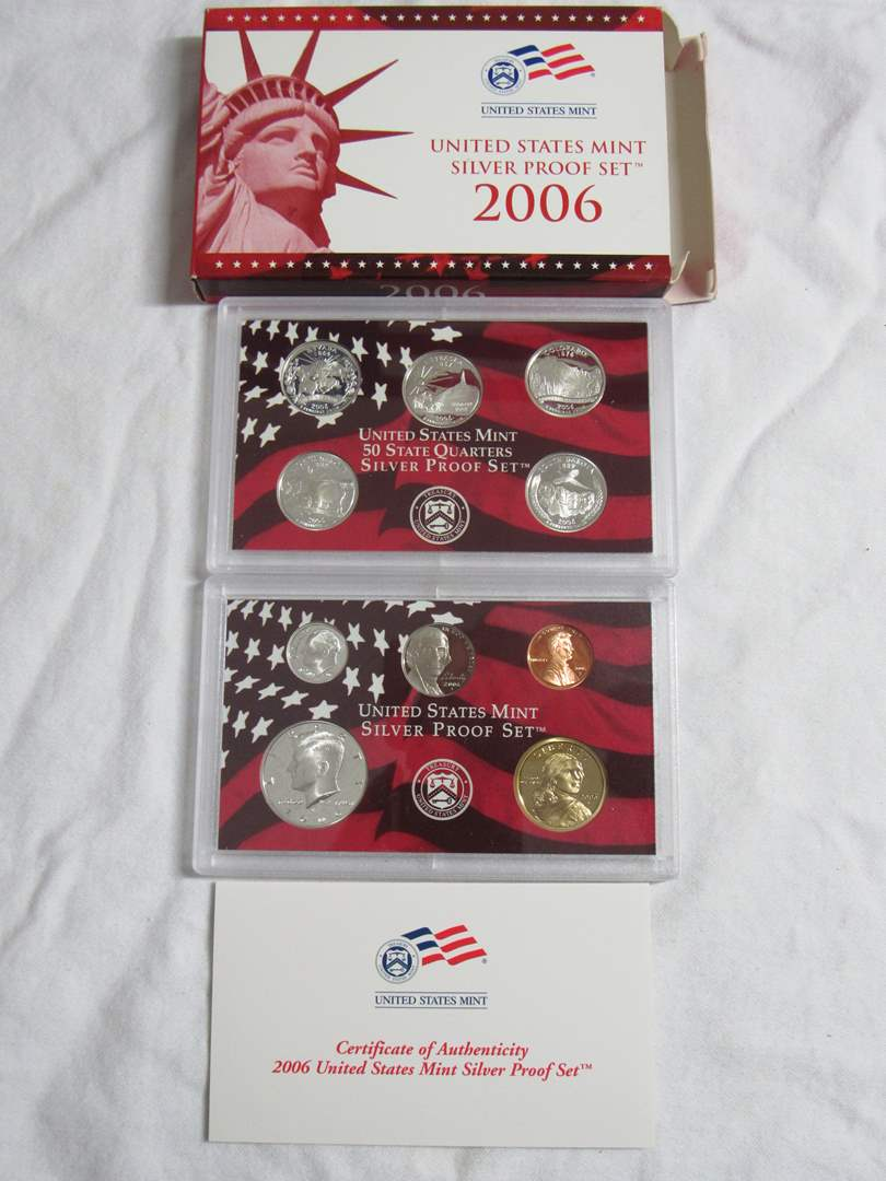 Lot # 141  2006 Mint SILVER PROOF coin set w/silver quarters and gold tone dollars (main image)
