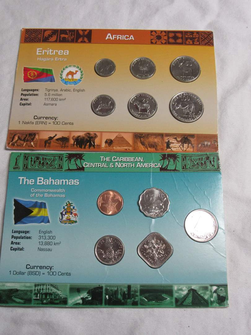 Lot # 187   2 great lots of displayed foreign coins untouched condition (main image)