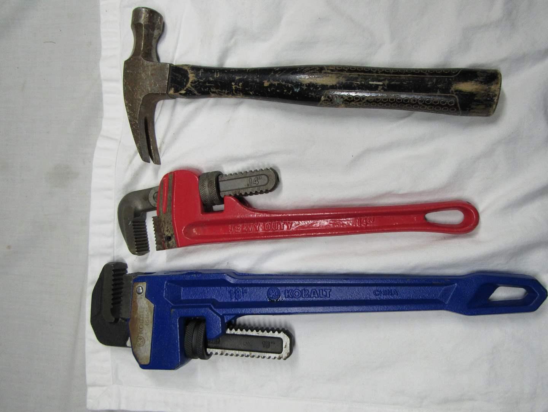 Lot # 196  2 Heavy duty pipe wrenches Kobalt & Heavy duty & hammer (main image)
