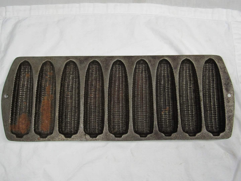 Lot # 199  Cast Iron RARE 8 slot corn muffin pan (not marked but definitely USA (main image)