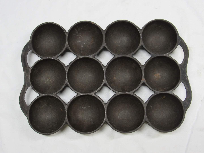 "Lot # 206  Vintage Wagner cast iron golf ball gem 12 slots 10X7""  (main image)"