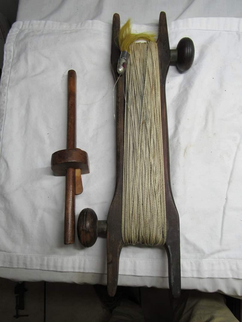 Lot # 217  WOW antique fishing reel w/lure (main image)
