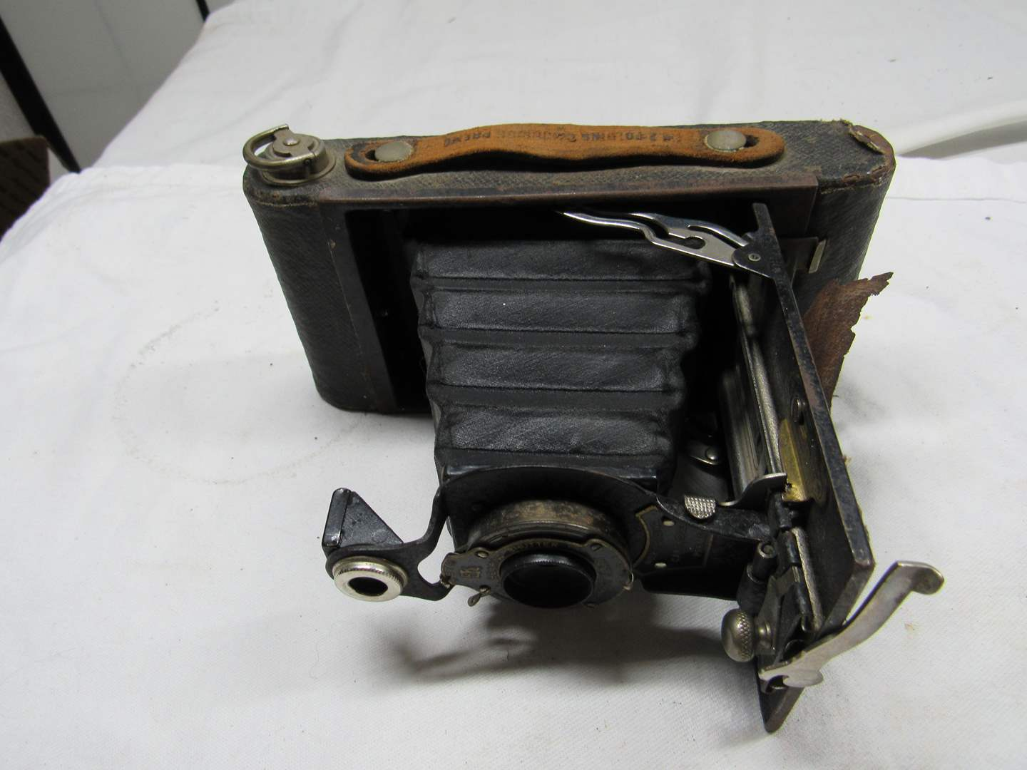Lot # 226  Antique Kodak camera (condition unknown) I did not try to close it (main image)