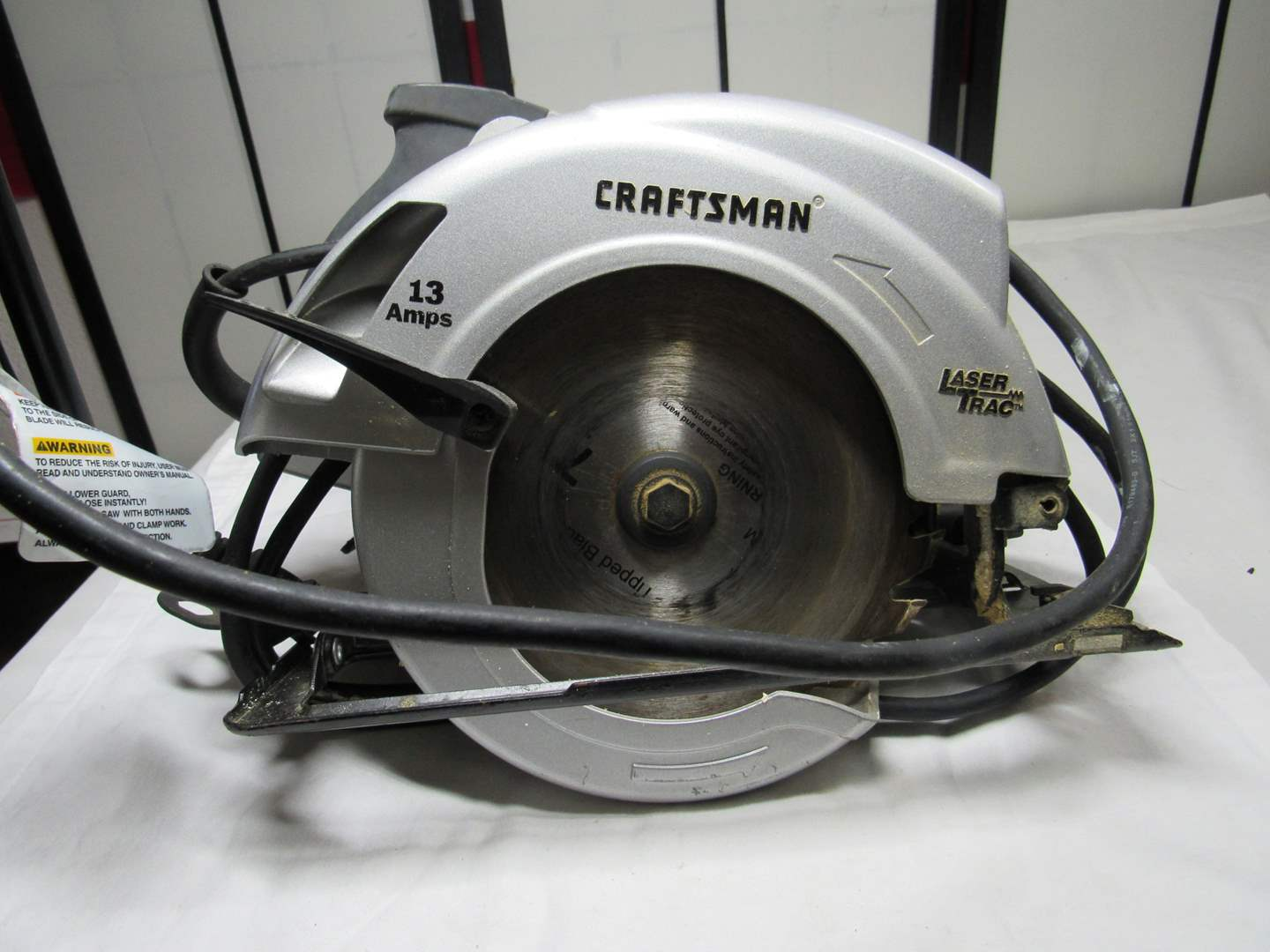 Lot # 262  Craftsman 13 AMP electric skil saw with laser light (small crack handle) (main image)