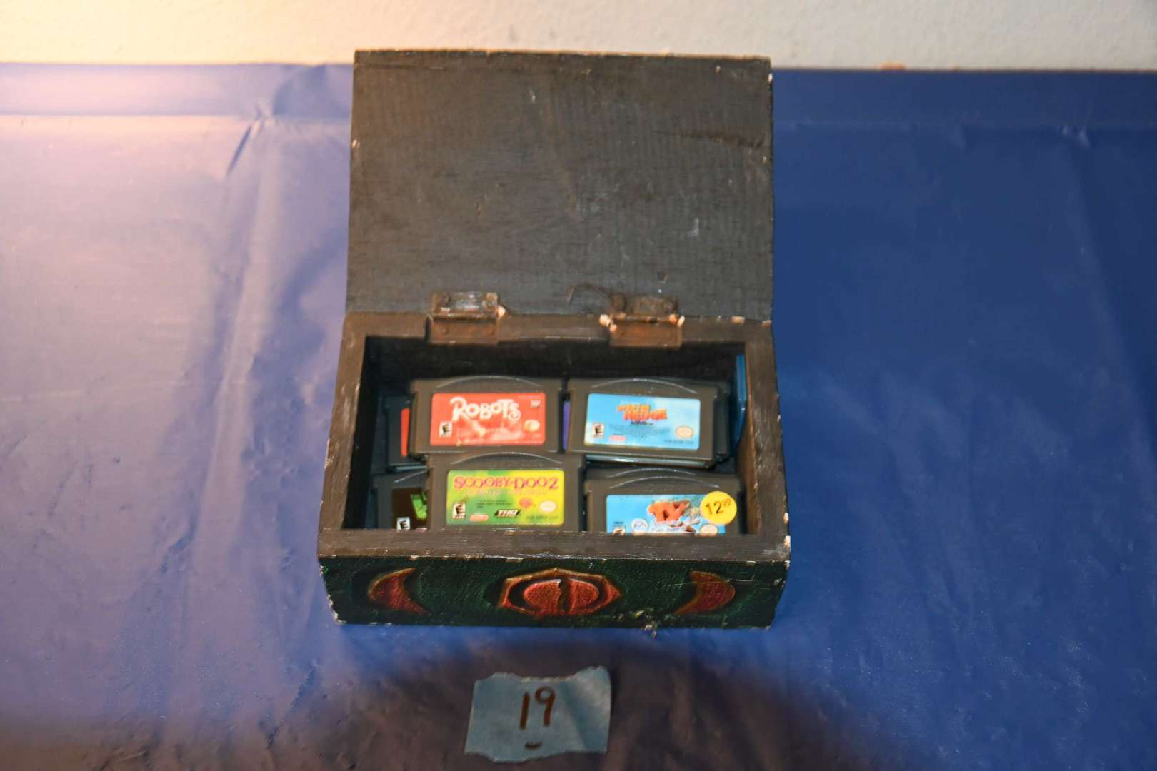 Lot # 19 12 Gameboy Advance games with trinket box