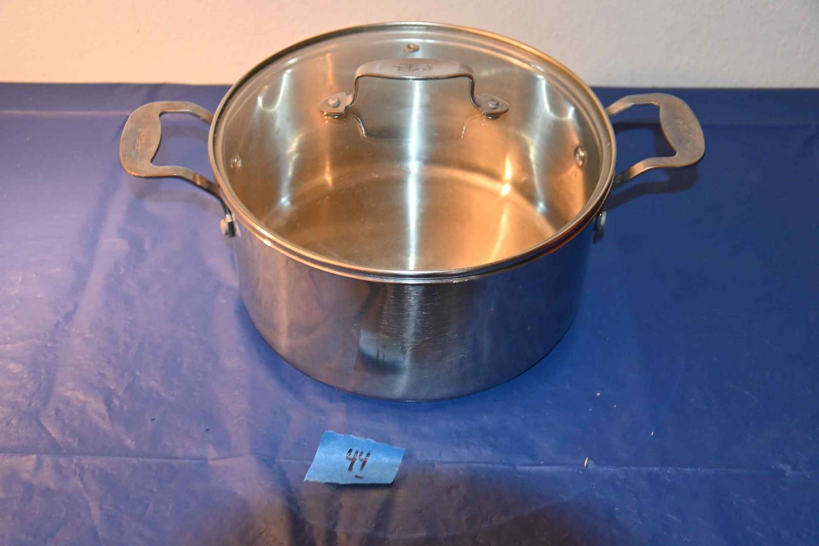 Lot # 44 T-FAL stainless pot with lid