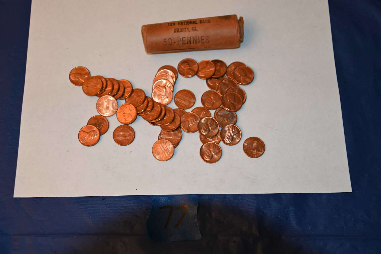 Lot # 77 1959 opened bank roll of pennies